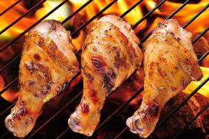 Grilled chicken legs on barbecue
