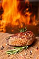 Grilled beef steak on a background of fire photo