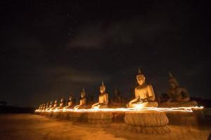Buddha statue on night photo