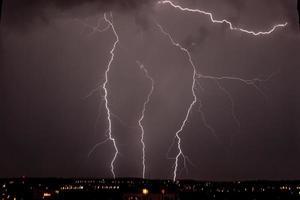 lightning storm over city photo