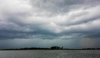 tybee island beach scenes during rain and thunder storm