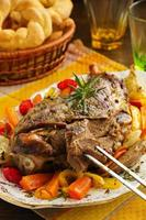 Roast leg of lamb with rosemary and garlic and vegetables. photo