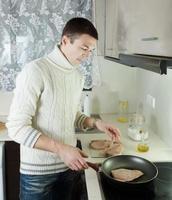 guy frying steak of porbeagle photo
