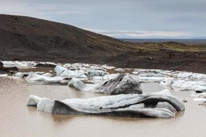 Glacier and lake with icebergs, Iceland photo