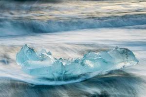 Beautiful blue ice on the black sand beach, Jokulsarlon, Iceland