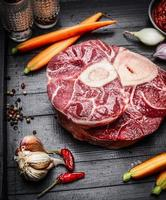 Veal shank slices meat and ingredients for Osso Buco cooking