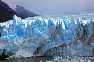 Perito Moreno glacier surrounded by mountains photo