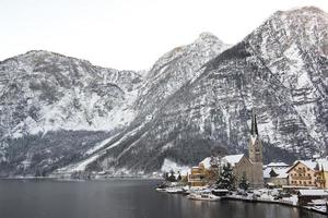 Winter landscape with mountains, snow and town Hallstatt, Austria