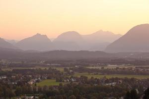 panorama of mountains in the alps at sunset photo