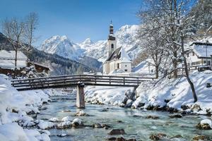 Scenic winter landscape in the Alps with church