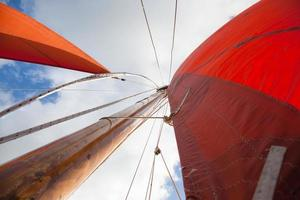 Wooden boat with sail photo