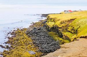 Icelandic beach with black lava rocks, Snaefellsnes peninsula, Iceland