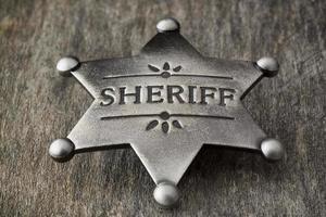 Old Sheriff Badge on Weathered Wood photo
