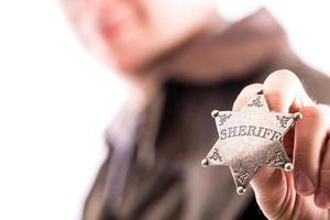 Man holds sheriff badge