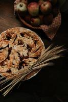 Fresh baked pie on brown wooden table
