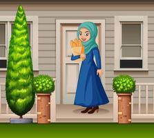 mujer árabe frente a la casa vector
