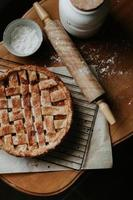 Baked pie on brown wooden table