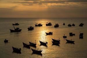 Small fishing boats during sunset photo
