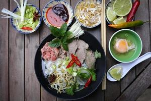 Pho, Vietnamese rice noodles with multiple side dishes