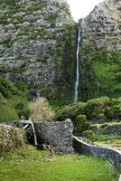 Old mill with waterfall, Azores (Portugal) photo