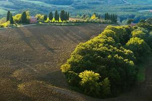 Plowed fields in the picturesque landscape of Italy. photo