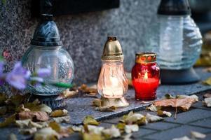 Lit grave candles