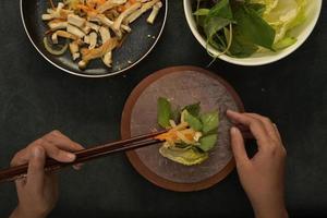 Making Vietnamese vegetarian wrap and roll