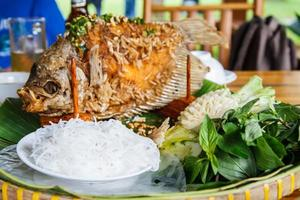 Fried fish prepared in the traditional Vietnamese photo