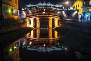 Old japanese bridge at night in Hoi An photo