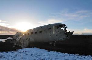 Abandoned aircraft at sunset