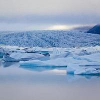 Beatiful vibrant picture of icelandic glacier and glacier lagoon with