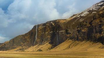 Beautiful Landscape of Icelandic mountain with small waterfall photo