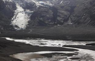Iceland. South area. Eyjafjalajokul glaciar tongue and river.