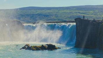 Beautiful vibrant panorama picture with view on waterfall in iceland