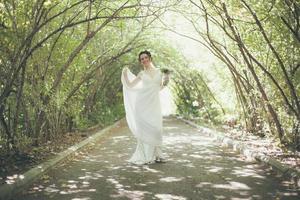 Bride wearing wedding dress alone photo