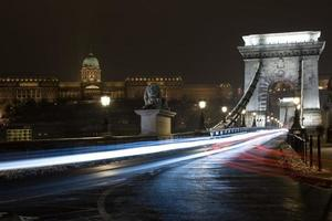 Chain bridge and Royal Palace in Budapest, Hungary by night
