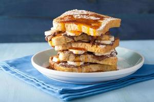 french toasts with banana chocolate sauce and caramel for breakf