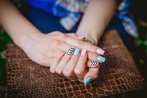 Women's manicure on a background of crocodile skins