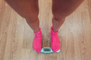 The girl standing on weigher photo