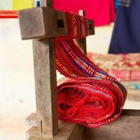 Handmade silk textile industry, scarf on a old machine