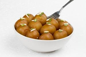 Gulab jamun with fork