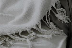 White fringed scarf