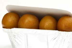 Gulab jamun in tin foil