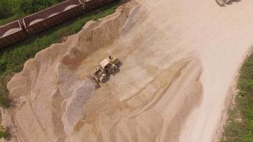 Quarry site and pile of gravel and stones at the train depot. video
