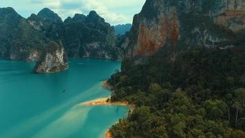 Aerial: Mountains and jungles on the lake with a bird's eye view. video