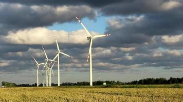 Wind power station turbines in sunny weather with clouds on wind video