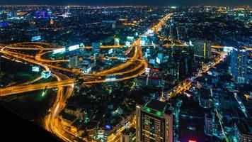 Time Lapse Night Cityscape Of Bangkok City, Thailand (tilt up)