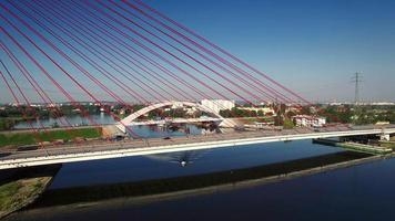Aerial View Of Boat Going Under Cable-Stayed Bridge