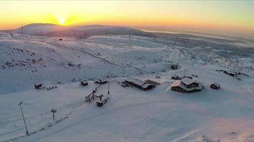 Flying over ski resort in the north at sunset video