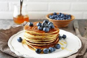 hot pancakes in stack with berries